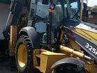 Экскаватор-погрузчик John Deere 325K 2012 объявление продам